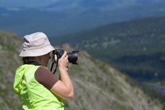 Nature photographer  on  mountain Royalty Free Stock Photo