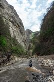 Nature photographer on mountain river in gorge. Nature photographer on mountain river in the gorge Stock Photo