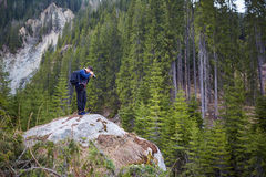 Nature photographer shooting Royalty Free Stock Image