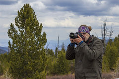 Nature photographer. Shooting in the mountains Royalty Free Stock Photo