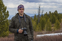 Nature photographer. Shooting in the mountains Royalty Free Stock Photography