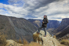 Nature photographer. Shooting in the mountains Stock Image