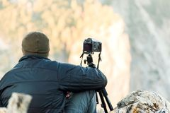 Nature photographer shooting in the mountains Royalty Free Stock Photography