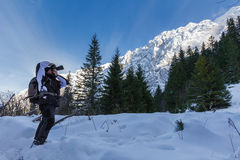 Nature photographer shooting winter landscapes Royalty Free Stock Photos