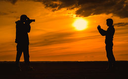 Nature photographer silhouette the sunset Royalty Free Stock Images