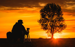 Nature photographer silhouette the sunset Royalty Free Stock Photo
