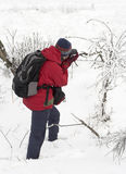Nature photographer in the snow royalty free stock photography