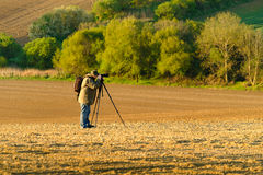 Nature photographer takes picture Royalty Free Stock Photography
