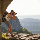 Nature photographer. Taking photos in the mountains Stock Photo