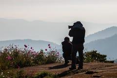 Nature photographer taking photos Stock Photo