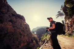 Nature photographer taking photos in the mountains Royalty Free Stock Photos