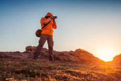 Nature photographer taking photos in the mountains Stock Photos