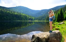 Nature photographer taking picture photos with DSLR camera. stock image