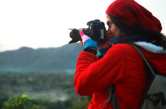 Nature photographer taking pictures during hiking trip Stock Images