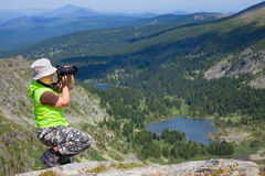 Nature photographer taking pictures outdoors Stock Images