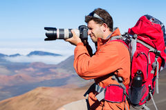 Nature Photographer taking Pictures Outdoors Stock Photography