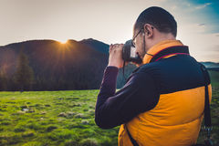 Nature photographer tourist in mountains Stock Image