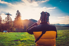 Nature photographer tourist in mountains Royalty Free Stock Images