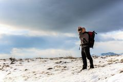 Nature photographer trekking in the mountains winter Stock Photography