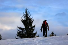 Nature photographer trekking in the mountains winter Royalty Free Stock Photo
