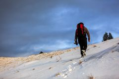 Nature photographer trekking in the mountains winter Stock Image
