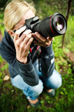 Nature photographer at work. In the garden Stock Image