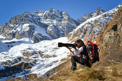 Nature photographer at work. Girl nature photographer. Gran Paradiso National Park, Italian Alps Stock Image