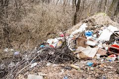 Nature pollution , people throws the garbage in the forest stock images