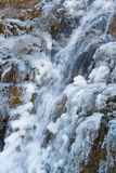 Nature power - close up of frozen natural mountain waterfall stock photography
