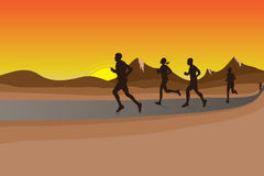 Nature Race. Runners doing marathon with sunset sky background Stock Photography