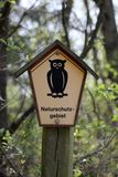 Nature Reserve In Germany. Nature reserve sign at Kieshofer Moor, Mecklenburg-Vorpommern, Germany. The owl in pentagon is one of the official signs indicating a royalty free stock images