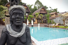 Nature resort. With pool and statue on Lake Batur in Bali, Indonesia Stock Photo