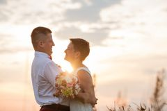 Nature romantic couple outdoor in the sunset royalty free stock photo