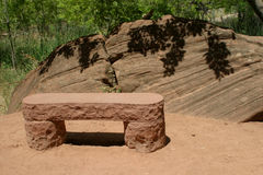 Nature's Bench. A natural stone bench awaits tired hikers in Zion National Park in Utah Royalty Free Stock Photo