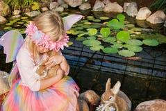 little fairy girl hugging a bunny Royalty Free Stock Photos