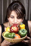 Nature's delight. Beautiful indian model girl holding fruits and vegetables in basket stock images