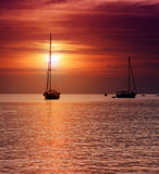 Sailboats at dusk. Stock Photo