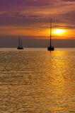 Sailboats at dusk. Tropical landscape Royalty Free Stock Photo