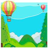 Nature scene with balloon over hills Stock Photo