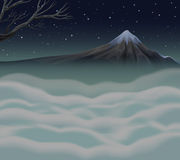 Nature scene with fog on the mountain peak Royalty Free Stock Photos