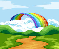 Nature scene with rainbow at the end of the road Royalty Free Stock Photography