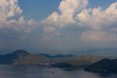 Nature scene of Srinagarind Dam with cloudy sky at kanchanaburi ,Thailand stock images