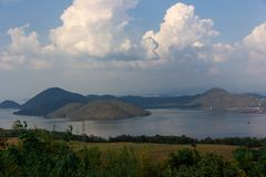 Nature scene of Srinagarind Dam with cloudy sky at kanchanaburi ,Thailand stock photography
