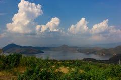 Nature scene of Srinagarind Dam with cloudy sky at kanchanaburi ,Thailand royalty free stock photos