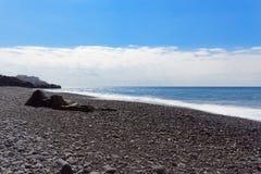 Nature scene of stone beach against blue sky. Madeira island. Nature scene of stone beach against blue sky. Praia Formosa beach in Funchal on Portuguese island stock photography