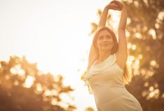 Nature sings the most beautiful songs. Happy pregnant woman spending time in nature. Copy space. Close up royalty free stock photography
