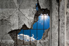 Nature sky view through the hole in a concrete wall Stock Image