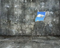 Nature sky view through hole on grey grunge concrete wall Stock Images