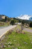 Nature: snow, road, mountains in gorge in Kazakhstan, Medeo Royalty Free Stock Photos