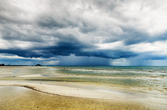 Stormy sky and beach at low tide Stock Photography